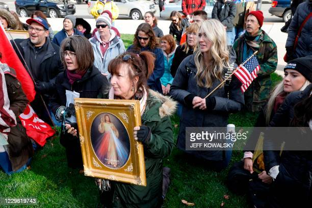 "People gather at the Michigan State Capitol for a ""Stop the Steal"" rally in support of US President Donald Trump on November 14 in Lansing, Michigan...."