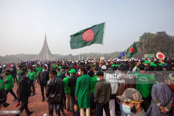 People gather at the national monument to mark the country's Victory Day. Bangladesh is celebrating the 49th anniversary of its victory in the...