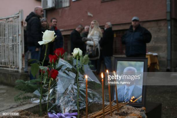 People gather at the office where Kosovo Serb politician Oliver Ivanovic was killed in northern town of Mitrovica Kosovo on January 16 2018 Kosovo...