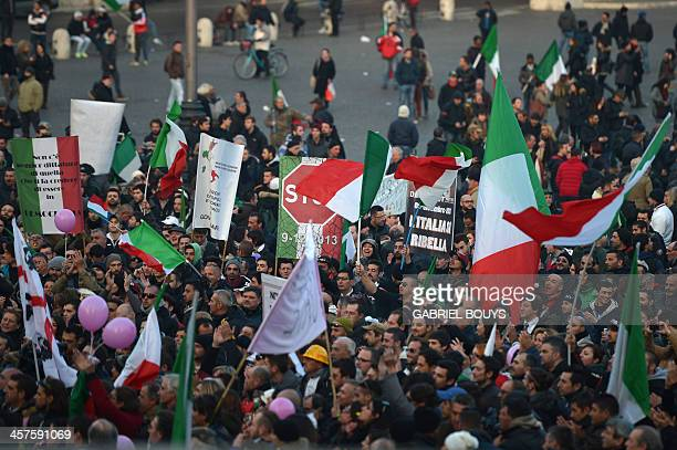 People gather at the Piazza del Popolo during a demonstration of the Forconi against austerity policies and the Italian government on December 18,...