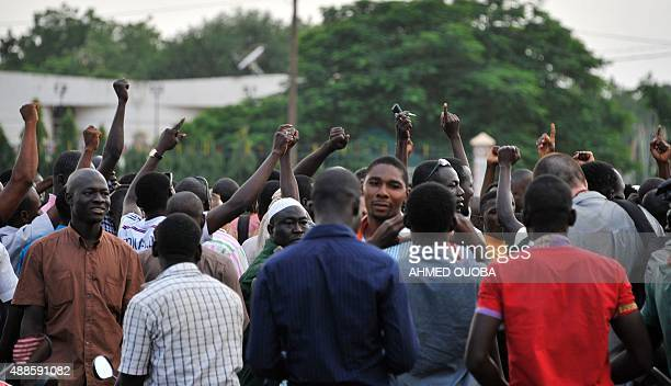 People gather at the Place de la Nation in Ouagadougou on September 16 few hours after Burkina Faso's interim President and Prime Minister were...