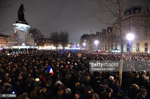 People gather at the Place de la Republique in Paris on January 7 following an attack by unknown gunmen on the offices of the satirical weekly...