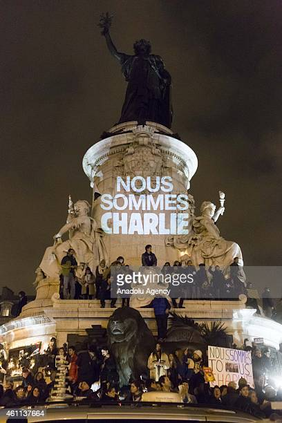 People gather at the Place de la Republique to protest against gun attack on the building of French magazine 'Charlie Hebdo', leaving 12 dead, in...