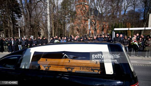 TOPSHOT People gather at the roadside as a hearse transports the coffin of Thomas Haller a leading figure in eastern Germany's farright scene and fan...