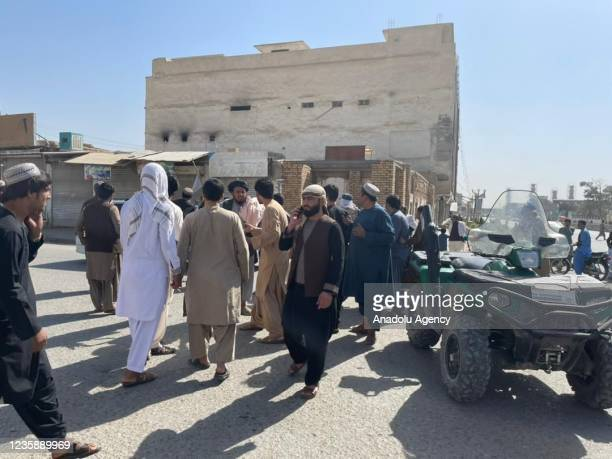 People gather at the scene after a bomb blast hits Shia community mosque in Afghanistanâs southern Kandahar province on October 15, 2021