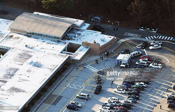 People gather at the scene of a mass school shooting at Sandy Hook Elementary School on December 14 2012 in Newtown Connecticut There are 27 dead 20...