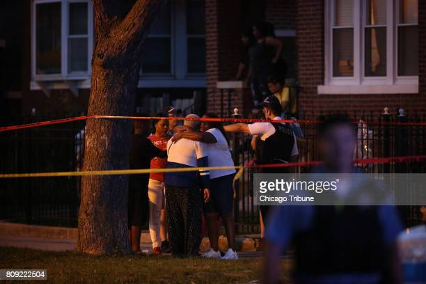 People gather at the scene where two were shot on the block of 1600 N Major in the North Austin neighborhood Tuesday July 4 2017 in Chicago