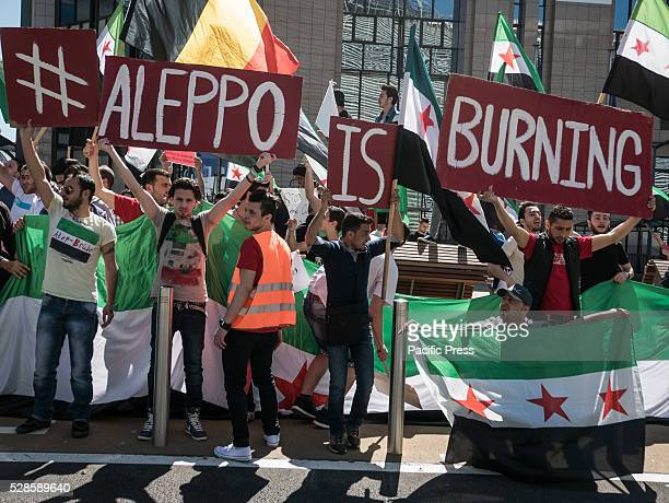 People gather at the Schuman Square and proceed in front of the European Council to protest and show solidarity with the civilians of Aleppo in Syria...