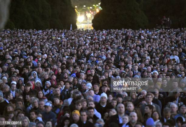 People gather at the Shrine of Remembrance for the Anzac Day dawn service in Melbourne on April 25 2019 Dawn services were held across the two...