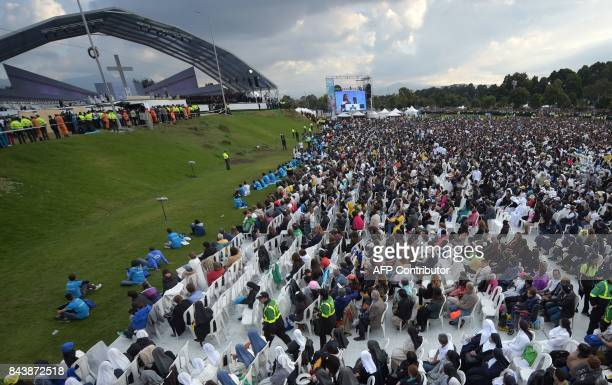 People gather at the Simon Bolivar Park in Bogota for an open air mass to be given by Pope Francis on September 7 2017 Pope Francis urged Colombians...