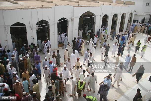 People gather at the site after the roof collapsed during the first Friday Prayer in the Muslim holy fasting month of Ramadan at the Usman Ghani...