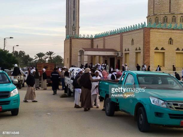 People gather at the site of the Egypt Sinai mosque bombing in AlArish Egypt on November 24 2017 The death toll from a bomb that went off outside a...