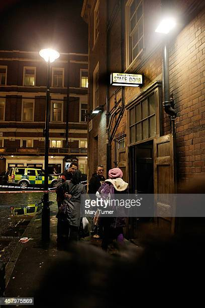 People gather at the stage door of the Apollo Theatre on Shaftesbury Avenue after the collapse of a balcony at historic theatre on December 19 2013...