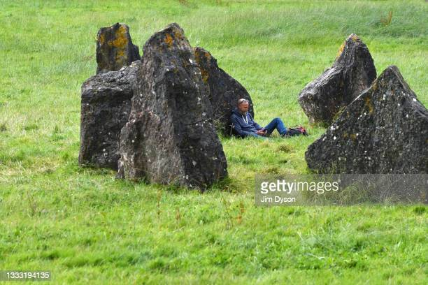 People gather at the stone circle at Worthy Pastures on the site of the Glastonbury Festival held at Worthy Farm, Pilton on August 07, 2021 in...