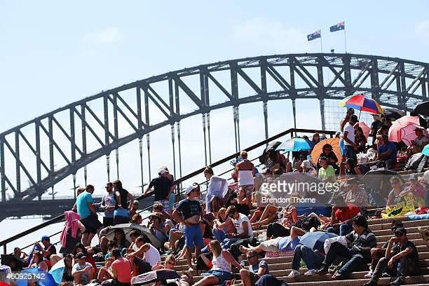 People gather at the Sydney Opera House to welcome in the new year on New Year's Eve on Sydney Harbour on December 31 2014 in Sydney Australia