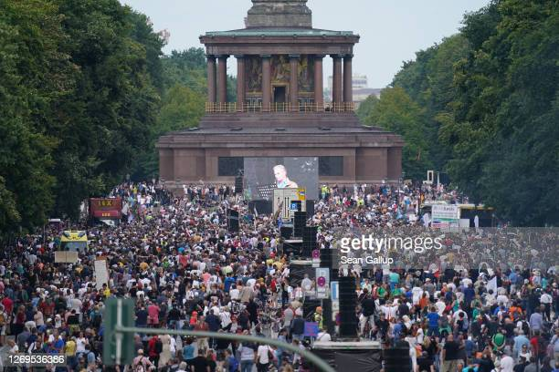 People gather at the Victory Column in the city center to hear speeches during a protest against coronavirus-related restrictions and government...