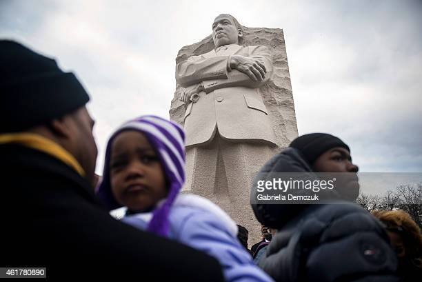 People gather at the wreath laying ceremony at the Martin Luther King Jr Memorial on the National Mall during MLK Day January 19 2015 in Washington...