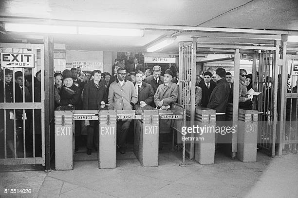 People gather at turnstiles of the Lexington Ave Subway at 42nd Street early November 10th waiting for trains to begin running again after power was...