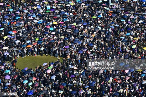 TOPSHOT People gather at Victoria Park for a prodemocracy rally in Hong Kong on December 8 2019 Hong Kong democracy protesters are hoping for huge...