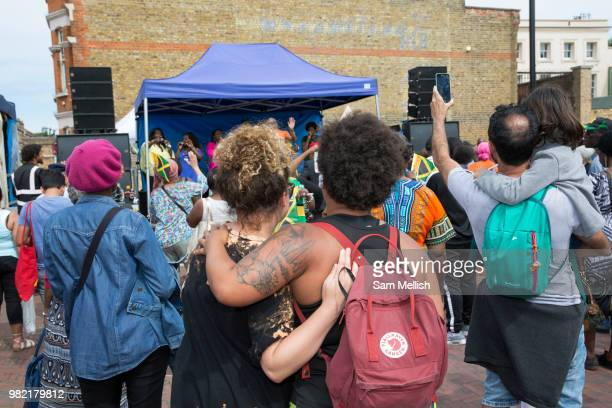 People gather at Windrush Square to celebrate the 70th anniversary of the arrival of the passenger liner Empire Windrush and the men and women who...
