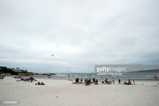 People gather at Wingaersheek Beach in Gloucester Massachusetts on August 15 2020 Over the past summer weekends hundreds of boats have tied up to the...