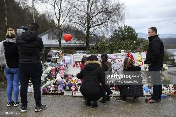 People gather by a makeshift memorial in front of the town's community centre in tribute to late eightyearold Maelys de Araujo on February 15 2018 in...