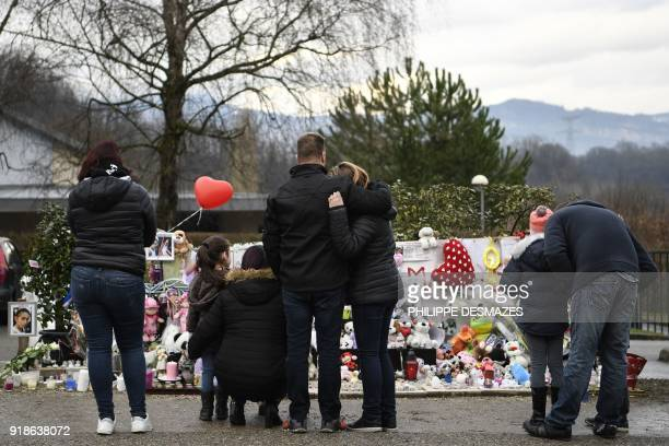 TOPSHOT People gather by a makeshift memorial in front of the town's community centre in tribute to late eightyearold Maelys de Araujo on February 15...
