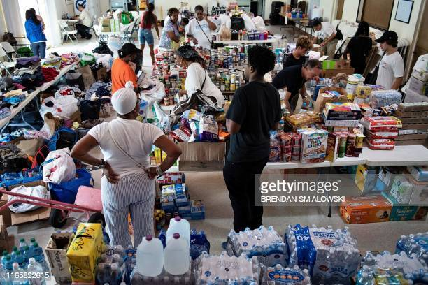 People gather donations for Hurricane Dorian relief at Christ Episcopal Church on September 3 in Miami, Florida. - Dorian crept towards the southeast...