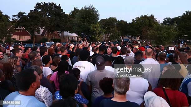 People gather during a commemoration ceremony, held for Sylville Smith, who was shot and killed by a police officer as he reportedly attempted to...