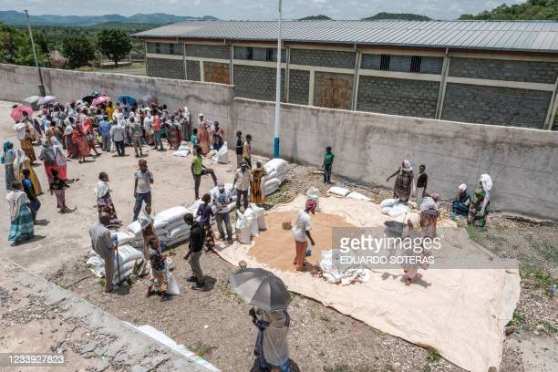 People gather during a food distribution organized by the Amhara government near the village of Baker, 50 kms South East of Humera, in the northern...