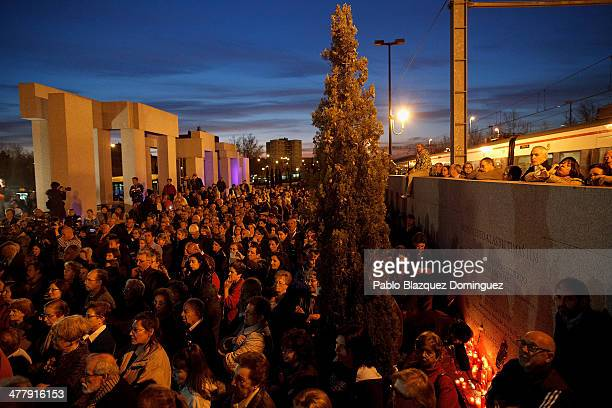 People gather during a memorial for the victims of Madrid train bombings outside El Pozo train station during the 10th anniversary on March 11 2014...