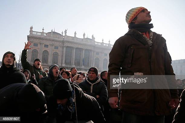 """People gather during a protest against austerity measures in """"Piazza Castello"""", in Turin on December 11, 2013. AFP PHOTO/MARCO BERTORELLO"""