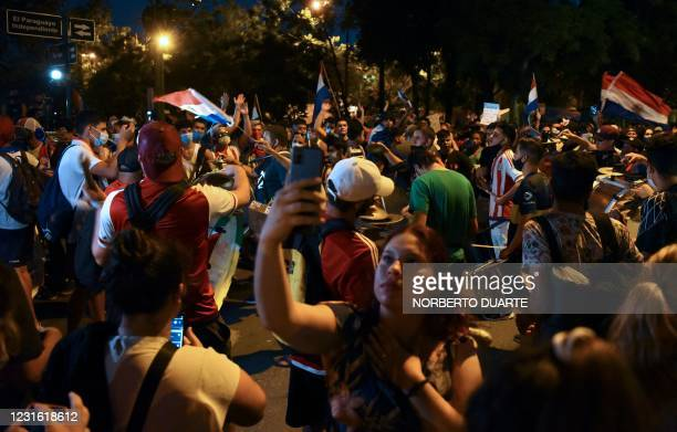 People gather during a protest against corruption and lack in the health system and demanding the resignation of Paraguayan President Mario Abdo...