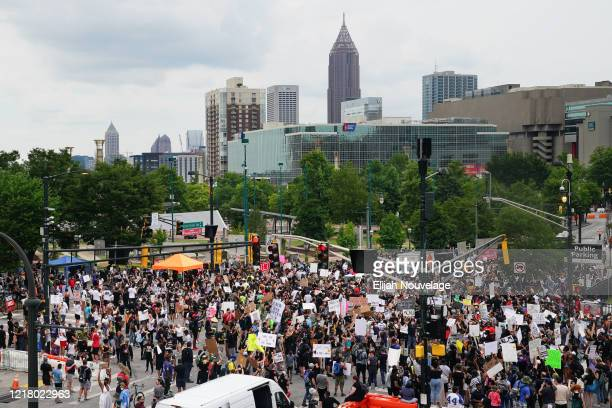 People gather during a protest against police brutality on June 6 2020 in Atlanta Georgia This is the 12th day of protests since George Floyd died in...