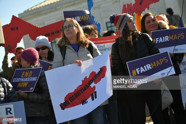 People gather during a rally to coincide with the Supreme Court hearings on the redistricting cases in Maryland and North Carolina, in front of the...