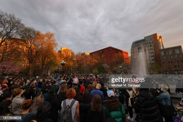 People gather during a vigil for Daunte Wright and Dominique Lucious at Washington Square Park in Manhattan on April 14, 2021 in New York City. The...