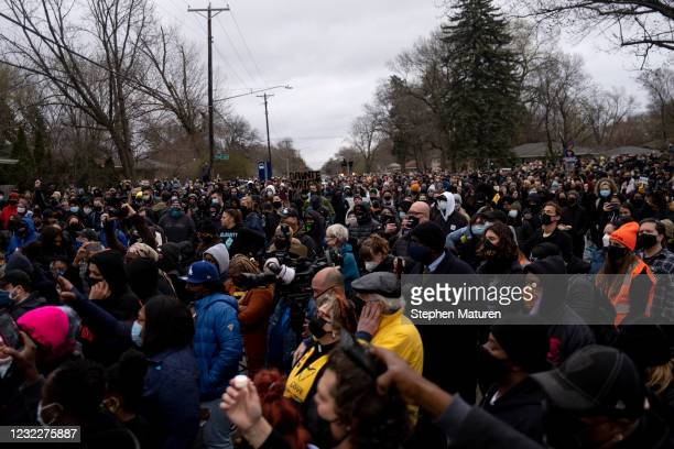 People gather during a vigil for Daunte Wright on April 12, 2021 in Brooklyn Center, Minnesota. Wright was shot and killed yesterday by Brooklyn...