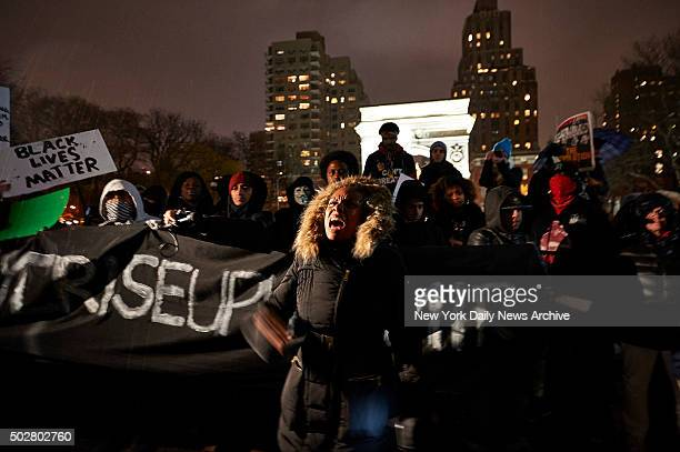 People gather during a vigil for police shooting victim Tamir Rice at Washington Square Park on Monday December 28 2015 in New York NY Prosecutors...