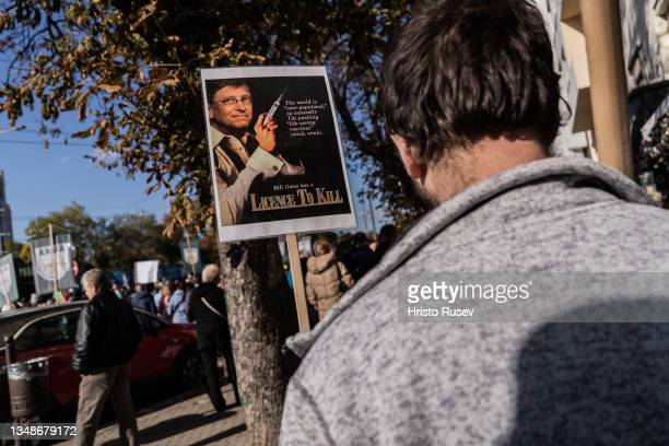 People gather during an anti-Covid-19 vaccine protest near a placard featuring Bill Gates on October 24, 2021 in Sofia, Bulgaria. With the lowest...