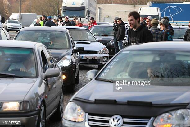 People gather during an event commemorating late US actor Paul Walker in GrootBijgaarden Belgium on December 8 2013 'Fast and Furious' star Paul...