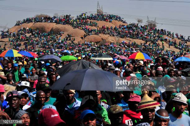 People gather during an event to commemorate the sixth anniversary of the Marikana massacre on August 16, 2018 in Rustenburg, South Africa. On August...