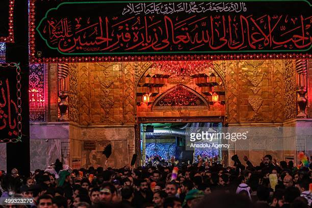 People gather during the Arba'een ceremony in the holy city of Karbala southern Iraq on November 30 2015 Hundreds of Shiite worshippers attend...