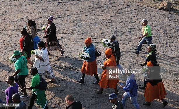 People gather during the commemoration of the 2012 Marikana massacre on August 16 2016 in Rustenburg South Africa August 16 2016 marks 4years since...