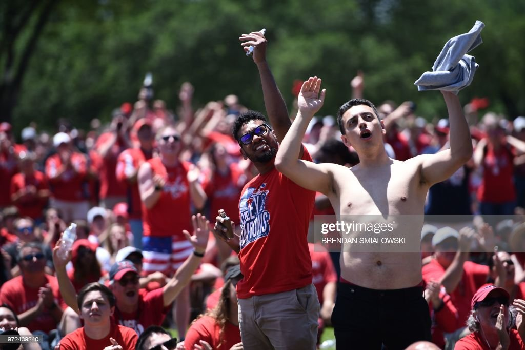 People gather during the Washington Capitals Stanley Cup NHL hockey victory parade on June 12, 2018, in Washington,DC.