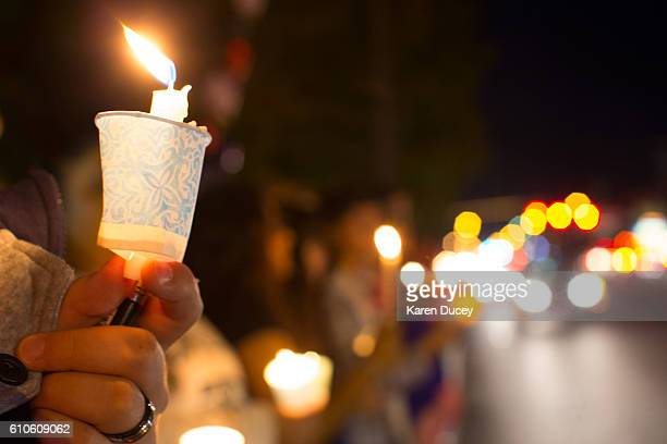 People gather for a candlelight vigil along Burlington Boulevard on September 26 2016 in Burlington Washington The vigil was held in memory of five...