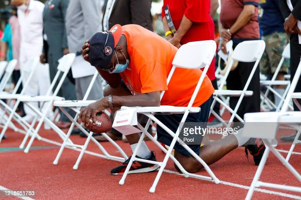 People gather for a candlelight vigil honoring George Floyd at the Jack Yates High School football field on June 8 2020 in Houston Texas