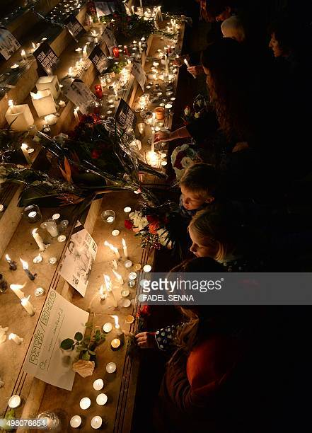 People gather for a candlelight vigil in Rabat on November 20 in solidarity with victims of the attacks in ParisThe UN Security Council on authorized...