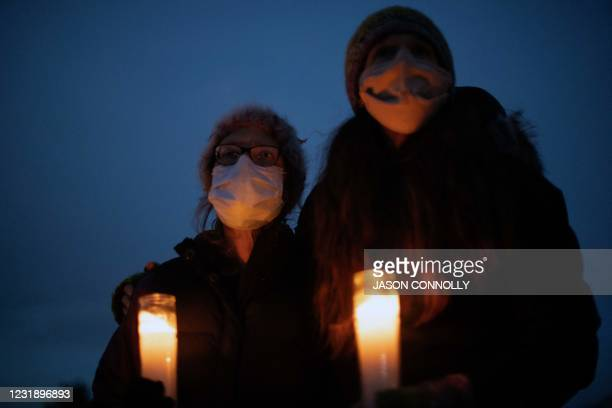 People gather for a candlelight vigil on March 23 to honor the ten victims of a mass shooting that occurred a day earlier at a King Soopers grocery...