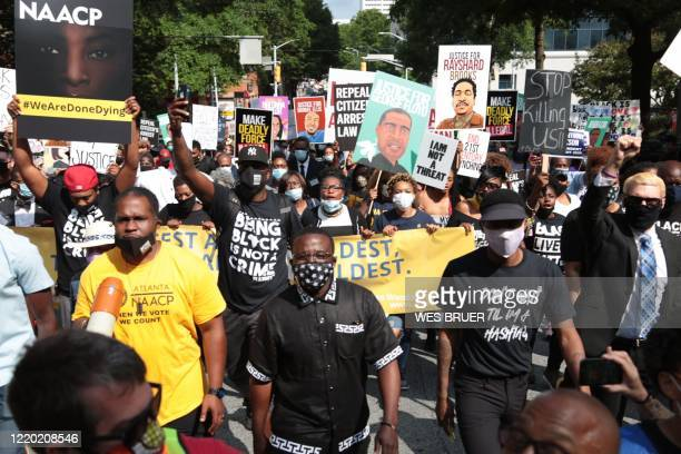 People gather for a civil rights National Association for the Advancement of Colored People protest march on June 15 2020 in Atlanta Georgia The...
