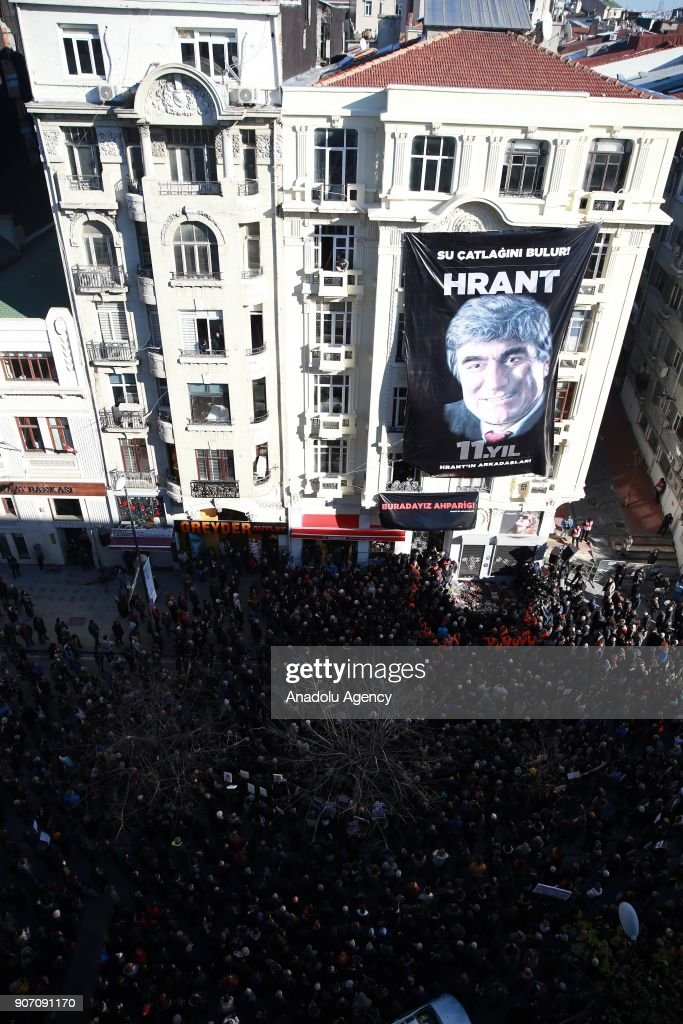 People gather for a commemoration ceremony in front of Agos newspaper building on the 11th death anniversary of Hrant Dink, former editor-in-chief of the bilingual Turkish-Armenian newspaper Agos, in Istanbul, Turkey on January 19, 2018. He was assassinated in front of the Agos newspaper building in Istanbul in 2007.